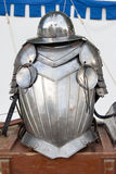 Middle ages body armor. Middle ages Knight body armor on wooden box royalty free stock photography