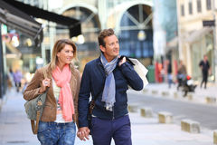 Middle-ages couple shopping in town. Middle-aged couple doing shopping on week-end stock photo