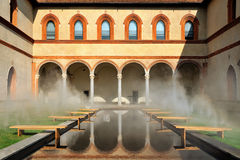 Middle Ages courtyard with pool in surreal fog Royalty Free Stock Photo