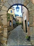 Medieval arch and street  in Tossa de Mar, Spain royalty free stock photo