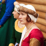 Middle ages period costume - young noble lady wearing red dress, a headgear and braids hairstyle royalty free stock image