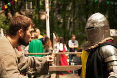 Middle ages period costumes at knight tournament. Khabarovsk, Russia - June 11, 2017: Medieval historical reenactment - two men talking royalty free stock photos