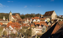 Middle Ages stacked. Panorama of the timbered houses and romanesque church of a medieval German town on a hill stock images