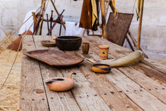 Middle ages table. A big and old wooden table with some medieval items on it royalty free stock photography
