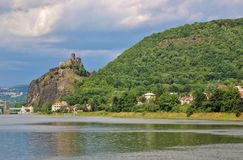 Middle Ages tower house Strekov in North Bohemia. Loom on the rock over a river stock image