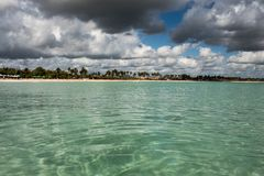 In the middle of an amazing, green and turquoise caribbean sea; transparent water, tropical paradise. Playa Macaro, Punta Cana,. Dominican Republic royalty free stock photos