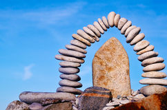 Middle of arc. Boulder in the middle arc of pebbles Royalty Free Stock Photography