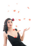 Middle asian girl with rose petals Royalty Free Stock Photo