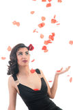 Middle asian girl with rose petals Stock Images