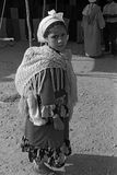 MIDDLE ATLAS MOUNTAIN, MOROCCO - JULY, 1979. – A girl shoulder her back to his younger brother in a Berber market on July, 1979, Middle Atlas Mountain Royalty Free Stock Photo
