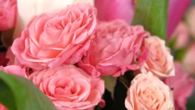 Middle of bouquet flower with roses and tulips, on red, green, rotation, close up stock footage