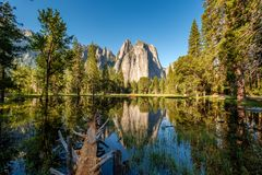 Middle Cathedral Rock reflecting in Merced River at Yosemite Stock Image
