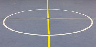 The middle circle on a blue indoor sports floor. royalty free stock photos