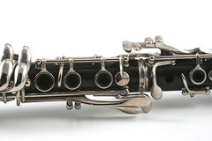 Middle of a clarinet with holes and keys. Against a white background Royalty Free Stock Photo