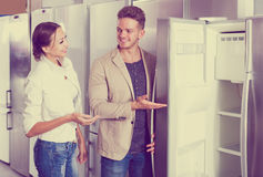 Middle class family couple choosing new refrigerator Stock Photo