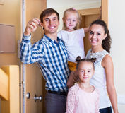 Middle class family in new house Stock Images