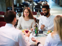 Middle class people enjoying food in cafe terrace. Happy european middle class people enjoying food in cafe terrace stock image