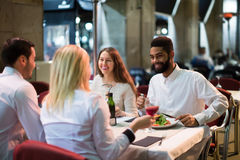 Middle class people enjoying food in cafe terrace Stock Photography