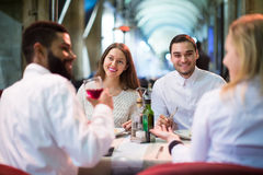 Middle class people enjoying food in cafe terrace. Happy spanish middle class people enjoying food in cafe terrace stock image