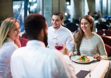Middle class people enjoying food in cafe terrace Royalty Free Stock Image
