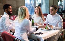 Middle class people enjoying food in cafe terrace. Smiling middle class people enjoying food in cafe terrace stock photos