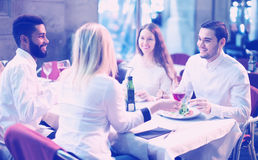 Middle class people enjoying food in cafe terrace. Smiling middle class people enjoying food in cafe terrace royalty free stock images