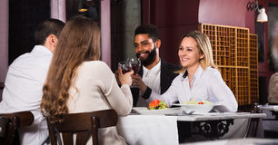 Middle class people enjoying food. Happy middle class people enjoying food and talking royalty free stock images