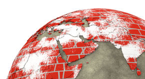 Middle East on brick wall Earth Stock Photo