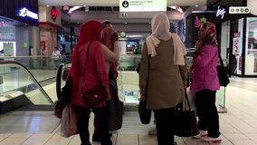 Middle East country women talking and say goodbye to each other stock video footage