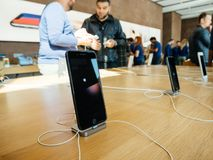 Middle east ethnicity friends discussing New iPhone 8 and iPhone. PARIS, FRANCE - SEP 22, 2017: New iPhone 8 and iPhone 8 Plus charging in docking station goes Stock Images