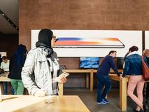 Middle-east ethnicity New iPhone 8 and iPhone 8 Plus in Apple St. PARIS, FRANCE - SEP 22, 2017: New iPhone 8 and iPhone 8 Plus, as well the updated Apple Watch Stock Image