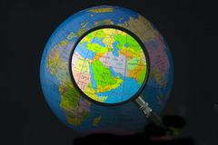 Middle East in focus. Magnifying glass focusing on Middle East Royalty Free Stock Photo