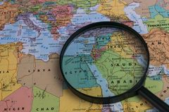Map of Middle East through magnifying glass on a world map. Middle East map through magnifying glass on a world map Stock Image