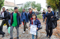 Middle East migrants. NOVA PAZOVA, SERBIA - CIRCA OCTOBER 2016: Migrants from middle east walks to Hungarian border, circa October 2016 in Nova Pazova royalty free stock photo