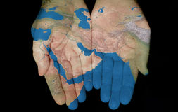 The Middle East In Our Hands. Map painted on hands showing concept of having the Middle East in our hands Royalty Free Stock Image