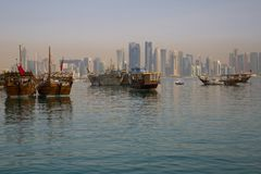 Middle East, Qatar, Doha, Harbour Boats & West Bay Central Financial District from East Bay District. View of Harbour Boats & West Bay Central Financial District stock photo
