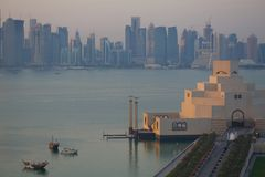 Middle East, Qatar, Doha, Museum of Islamic Art & West Bay Central Financial District from East Bay District at Dusk. View of Museum of Islamic Art & West Bay stock photos