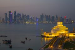 Middle East, Qatar, Doha, Museum of Islamic Art & West Bay Central Financial District from East Bay District at Dusk Royalty Free Stock Photography