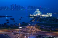 Middle East, Qatar, Doha, Museum of Islamic Art & West Bay Central Financial District from East Bay District at Dusk Stock Photos