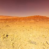 Middle East at sunset. Rocky hills of the Negev Desert in Israel. Breathtaking landscape and nature of the Middle East at sunset royalty free stock photo