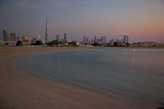 Middle East, United Arab Emirates, Dubai, City Skyline & Burj Khalifa at Sunset from Jumeirah Beach. View of Skyline Stock Photography