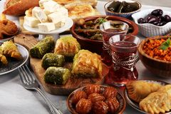 Middle eastern or arabic dishes and assorted meze, concrete rust. Ic background. sambusak. Turkish Dessert Baklava with pistachio. Sarma, Rice and mint wrapped stock photography