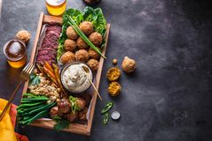 Middle eastern or arabic dishes and assorted meze on a dark background. Meat, falafel, baba ghanoush, vegetables. Halal royalty free stock photography