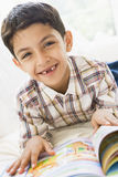 Middle Eastern boy reading Royalty Free Stock Photos