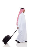 Middle eastern business traveler. Side view of middle eastern business traveler isolated on white Stock Photos