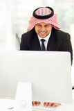 Middle eastern businessman computer Stock Photo