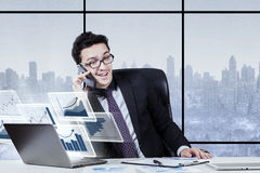 Middle eastern businessman is discussion by cellphone Royalty Free Stock Images