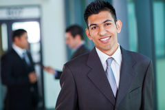 Middle eastern businessman. Happy modern middle eastern businessman in office Royalty Free Stock Photography