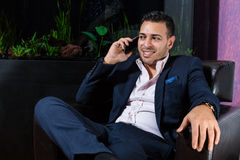Middle Eastern businessman in the office. While speaking at telephone royalty free stock images