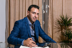 Middle Eastern businessman in the office. Middle Eastern businessman standing in front of the desk stock photography